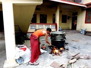 A Monk preparing lunch at Sera Mey Tsangpa Khangtsen